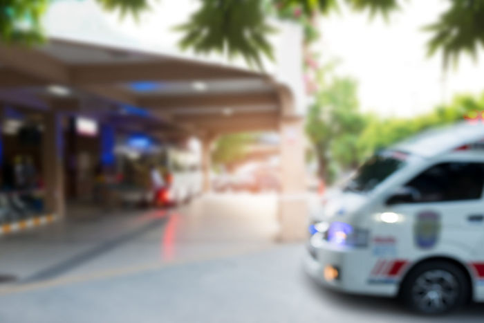Defocused of ambulances . Ambulances with emergency light at city hospital ,blurred for background. Emergency Emergency Vehicle Hospital URGENT Accident Ambulance Emergency Lighting Healthcare And Medicine