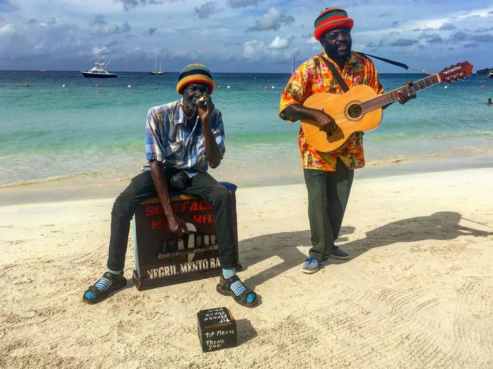 Negril Mento Band, Jamaica 7 Mile Beach Jamaica Negril Music Mento Music Sea Beach Real People Full Length Two People Sand Horizon Over Water Men Vacations Day Lifestyles Togetherness Water Adult People Summer Exploratorium Moments Of Happiness