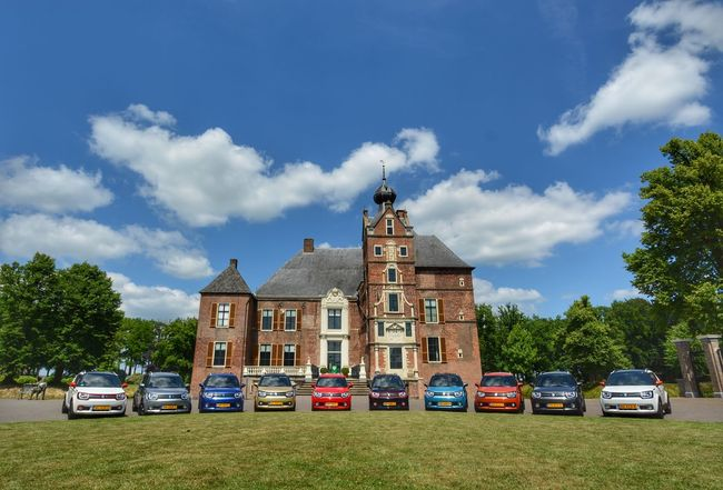 Car Cloud - Sky Transportation Land Vehicle Mode Of Transport Sky Architecture Building Exterior Stationary Day Built Structure Blue Outdoors No People Tree Grass The Netherlands Meeting Place Suzuki Suzuki Ignis Castle De Cannenburgh
