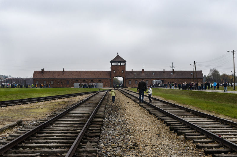 Main entrace to Auschwitz Birkeanu II, in black and white Copy Space Main Entrance Memorial Nikon D5100  Poland Auschwitz Birkenau Concentration Camp Day Enjoying Life Extermination Camp Holocaust Horizontal Shot Nazis Nazism Rail Transportation Railroad Track Real People World War