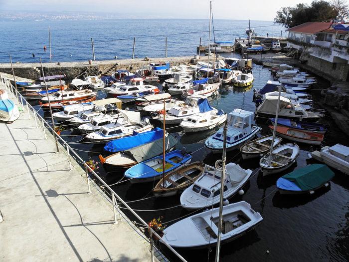 High angle view of boats moored at shore