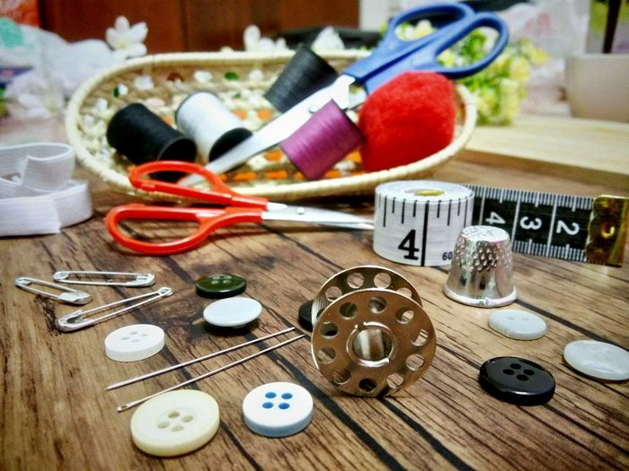 Close-up of various sewing items on table
