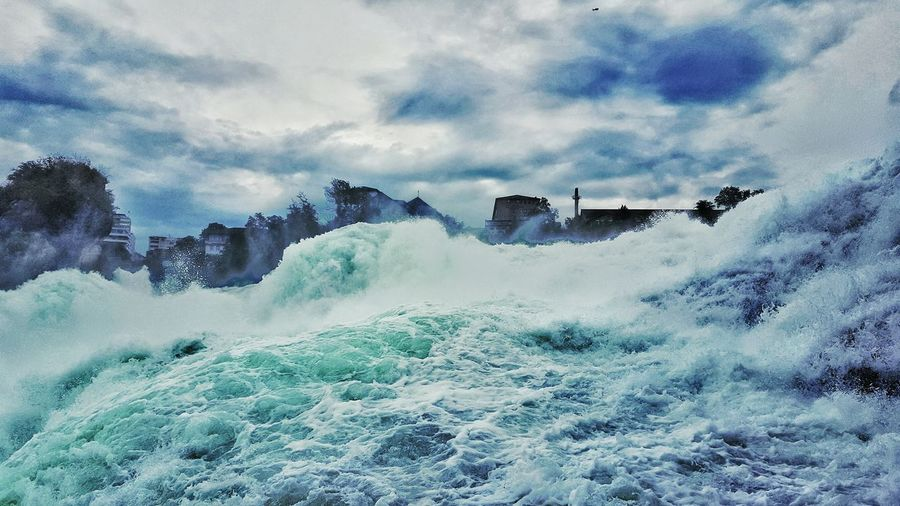 Panoramic view of waves in sea against sky