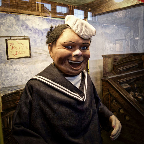 The Jolly Jack Arcade Coin Operated Disturbing Fisherman's Wharf Frightening Front View Handsome Jolly Looking At Camera Mannequin Mechanical Musee Mecanique Navy Sailor Smiling Waist Up Wooden Man Glass Enclosed Eyes Watching You Look Me In The Eyes Look At Me Looking Into The Camera