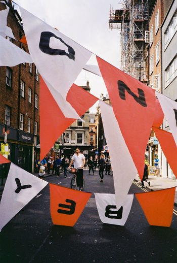 35mm 35mm Film 35mmfilmphotography Analogue Photography Festival Season Film Letters London London Lifestyle Analog Architecture Building Exterior Built Structure City City Life Festival Film Photography Flag Outdoors People Street Streetphotography Walking
