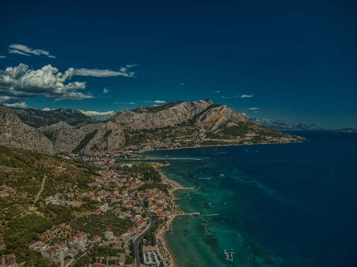Scenic view of sea and mountains against blue sky croatia