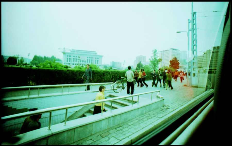 Within the Streets of Pyongyang Analogue Photography Architecture Armchair Armchair Row ASIA Bridge Dog Dish DPRK Eating Dog Hotel Hotel Telephone Hotel Window Juche Kim Il Sung Lomography Marching Northkorea Propaganda Pyongyang Pyongyang Skyline Pyongyang Streets Seats In Row Street Xpro Yanggakdo