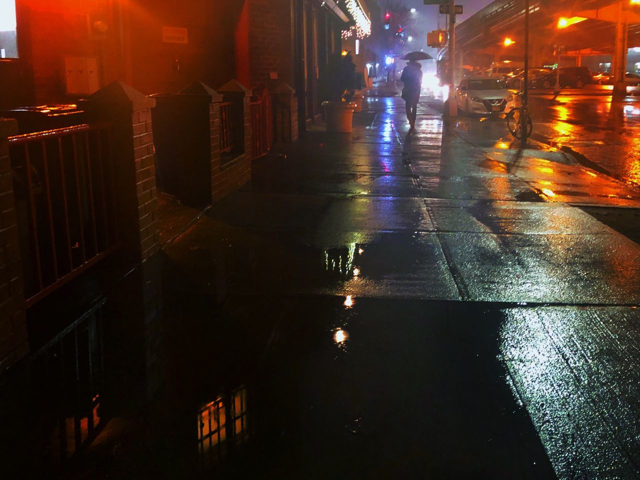 illuminated, night, wet, city, architecture, street, built structure, building exterior, rain, reflection, incidental people, water, transportation, road, building, the way forward, motor vehicle, car, rainy season, outdoors