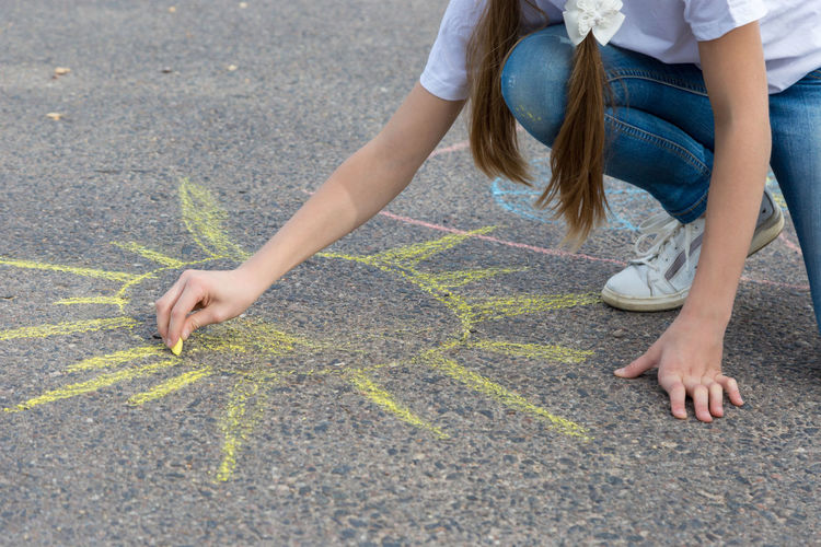 children draw in crayon on asphalt Happiness Sunshine Friendship Doodle Sketching Game Chalking Pavement Colorful Activity Creative Playground Happy Lifestyle Playing Coloring Painting Leisure Activity Leisure Education Artist Sun Cute Play People Image Draw Art Outside Street Sidewalk Closeup Close Up Hand Color Outdoor Day Summer Crayons Children Family Chalk Drawing Asphalt Creativity Child Childhood Copy Space Copyspace Girl