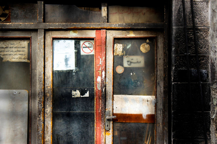 Closed glass door of abandoned building