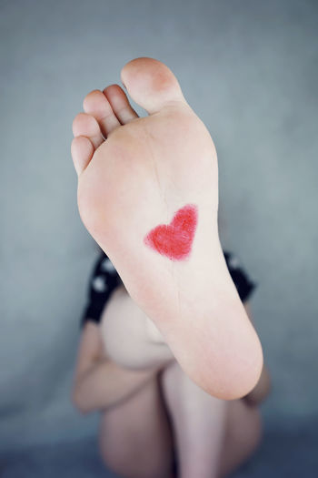 barefoot Childhood Close-up Day Focus On Foreground Heart Shape Human Body Part Human Hand Indoors  Leisure Activity Lifestyles One Person People Real People Red