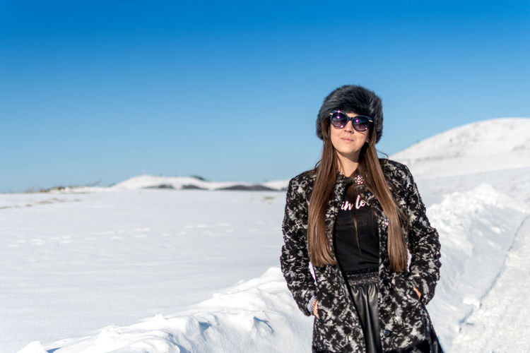 One Person Glasses Fashion Leisure Activity Clothing Sunglasses Snow Portrait Lifestyles Winter Cold Temperature Day Nature Real People Young Adult Looking At Camera Sunlight Adult Warm Clothing Beautiful Woman Outdoors