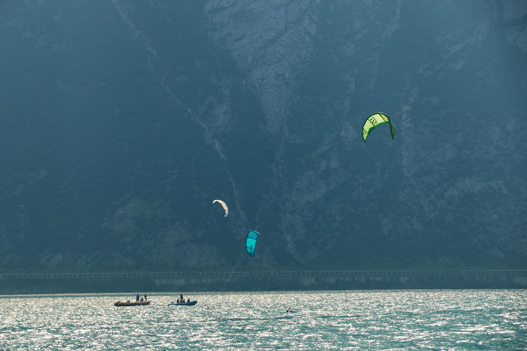 People paragliding over sea