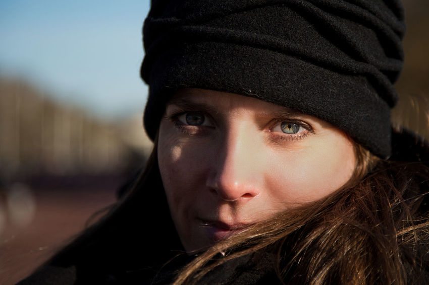Adult Black Hat Bundled Up Cold Day Golden Hours Headshot Human Face Outdoors People Portrait Scarf Setting Sun Side Light Woman