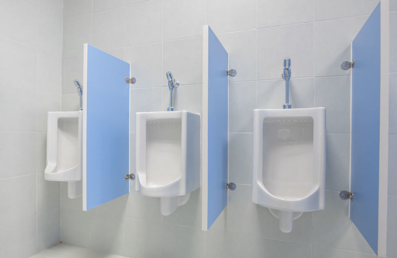 Architecture Bathroom Blue Convenience Day Flushing Toilet Hygiene Indoors  No People Public Building Public Restroom Toilet Urinal White Color