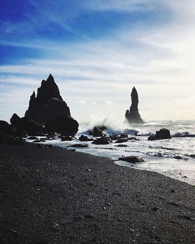 Reynisdrangar Travel Travel Destinations Iceland Splashing Splash Wave Reynisdrangar Reynisfjara Vík í Mýrdal Rock Formation Rock - Object Sea Beach Beauty In Nature Nature Sand Tranquility Tranquil Scene Scenics Sky Water Outdoors No People Day