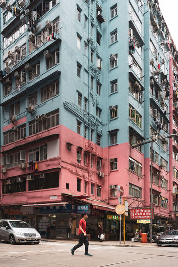 Tai Kok Tsui Old Buildings One Person EyeEm Best Shots EyeEm Gallery EyeEm Selects Motor Vehicle Car City Architecture Building Exterior Mode Of Transportation Built Structure Transportation Land Vehicle Street Building Residential District City Street City Life Outdoors Road Incidental People Apartment The Street Photographer - 2019 EyeEm Awards
