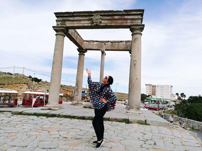 Woman Posing While Standing By Los Cuatro Postes De Avila Against Sky