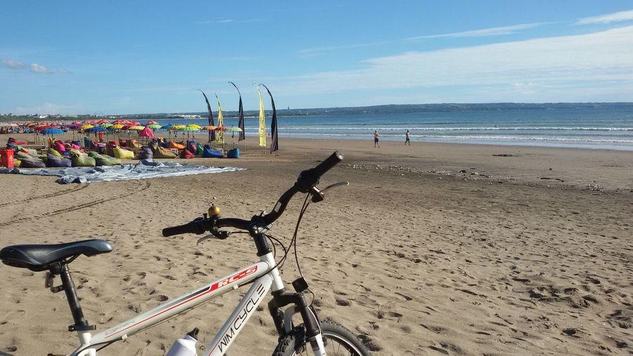 My white bike & colorfull beach TakeoverContrast Beach Cycling Doublesixbeach Kuta Bali