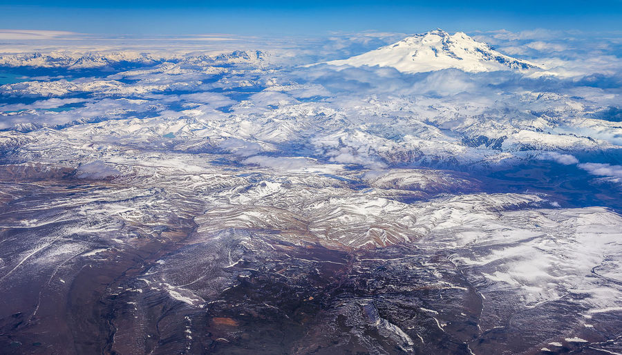 Volcano mountain in South America Aerial View Beauty In Nature Cold Temperature Dramatic Landscape Environment Landscape Mountain Mountain Peak Mountain Range Nature No People Non-urban Scene Outdoors Physical Geography Scenics - Nature Sky Snow Snowcapped Mountain Tranquil Scene Tranquility Winter