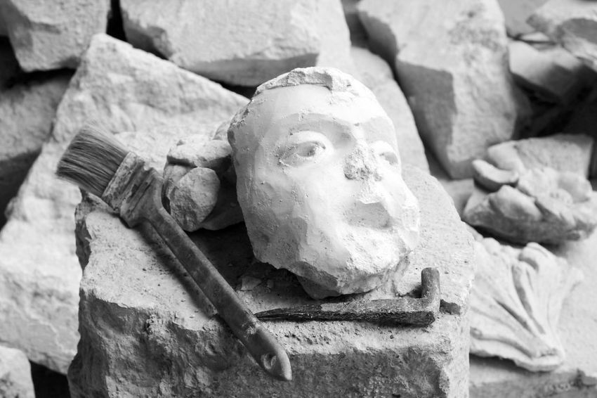 Particular fall sculpture due to earthquake in L'Aquila Abruzzo L'Aquila Rubble Wall Art And Craft Black And White Blackandwhite Brush Close-up Earthquake Earthquake In Italy Earthquake L'aquila Face Human Body Part Human Face Human Representation Italy Marble Rock - Object Rubble Sculpture Statue Stone Material