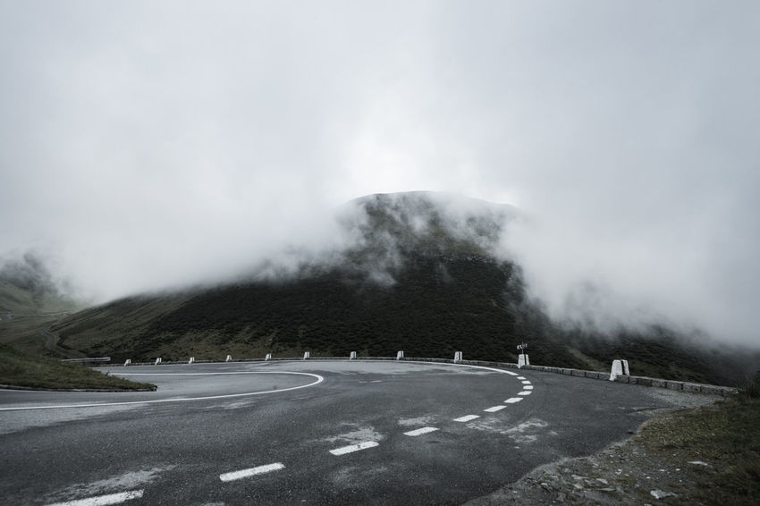 Autumn Beauty In Nature Cold Temperature Curve Fog Furkapass Landscape Mountain Pass Mountain Road Outdoors Road The Way Forward Winding Road