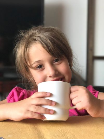 Portrait Of Girl Having Milk At Home