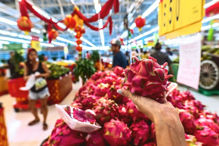 Red flowers at market stall