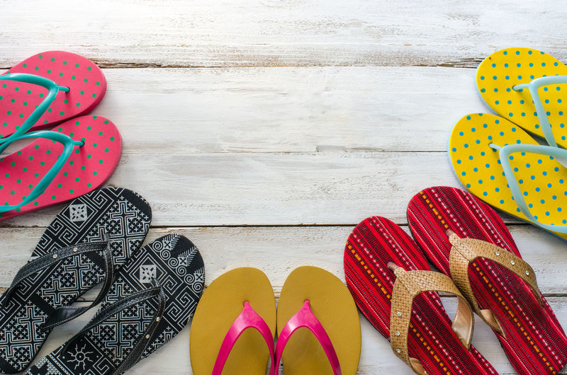 Directly Above Shot Of Flip-Flops On Wooden Table