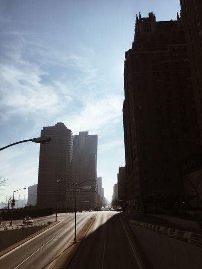 Highway in city against sky