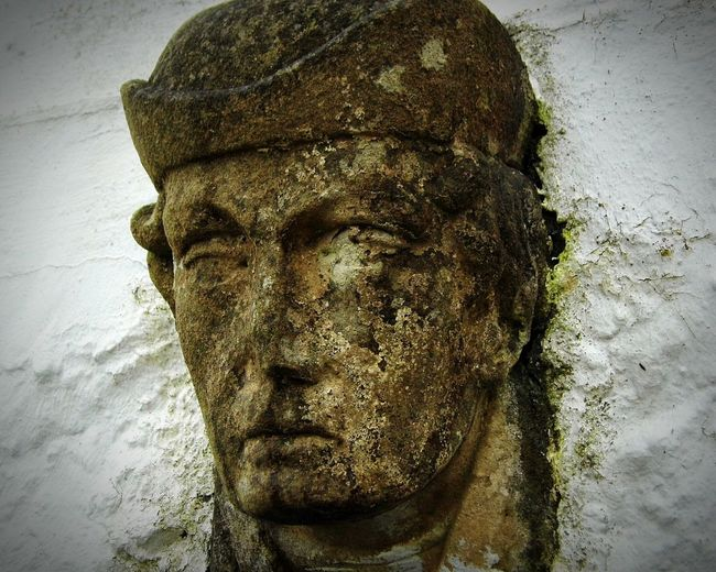 Stone Face Statue Weathered Worn Old Chipped Staring At The World Textures And Surfaces Rough Aged Stone