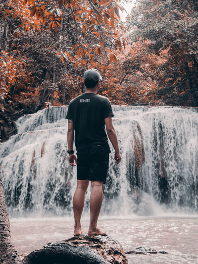 Tree One Person Full Length Plant Nature Standing Water Rear View Lifestyles Day Real People Leisure Activity Motion Forest Autumn Men Beauty In Nature Casual Clothing Change Outdoors Flowing Water Power In Nature