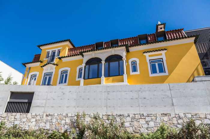 Architecture Balcony Blue Building Exterior Built Structure Clear Sky Day Leiria Low Angle View Nature No People Outdoors Portugal Sky The Architect - 2017 EyeEm Awards Window Yellow