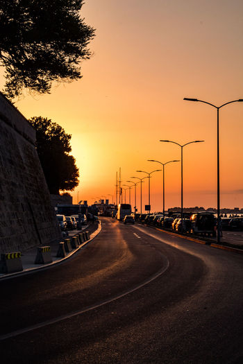 sunset Zadar Zadar Sunset Zadar,Croatia Car City Diminishing Perspective Direction Land Vehicle Mode Of Transportation Motor Vehicle Nature No People Orange Color Outdoors Plant Road Sign Sky Street Street Light Sunset Symbol The Way Forward Transportation Zadar Old Town