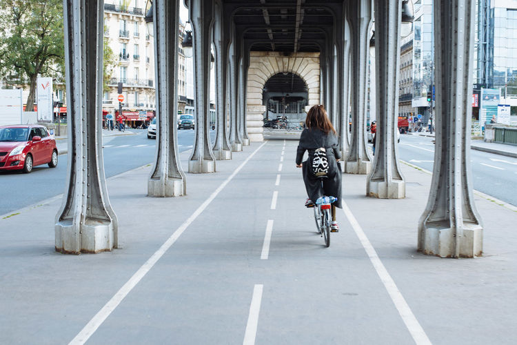Bicycle Bridge City Life Cycling Exploring France Full Length Leisure Activity Lifestyles Paris Paris ❤ Pont De Bir-hakeim Real People Rear View Riding Tourism Tourist Spot Transportation Urban Women