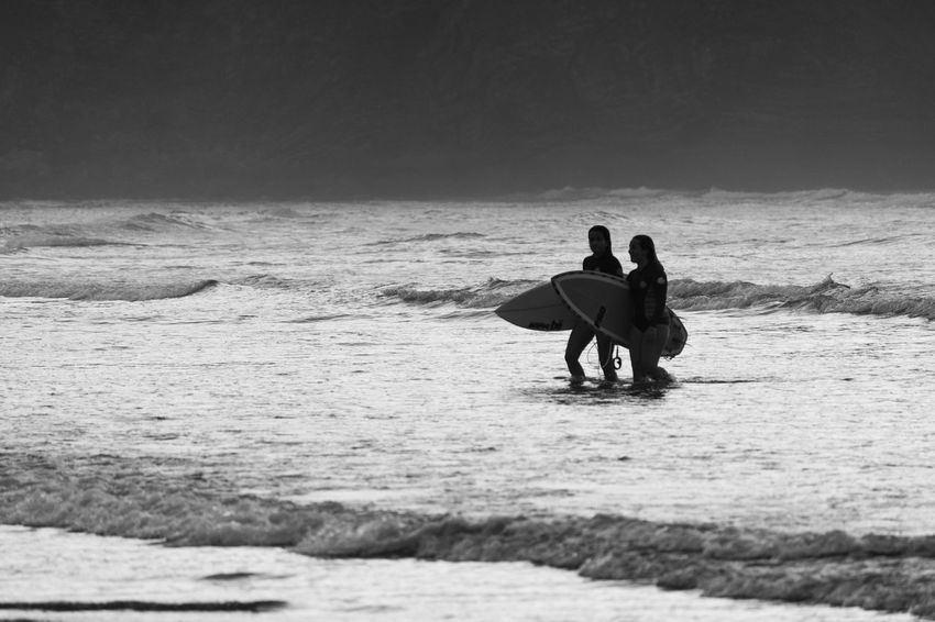 Beach Sand Sea Women Togetherness Horizon Over Water Outdoors Water People Nature Full Length Adult Vacations Real People Sky Day Adults Only Only Men Sand Dune B&w Surf Photograph B&wsurf B&w Photography Black And White