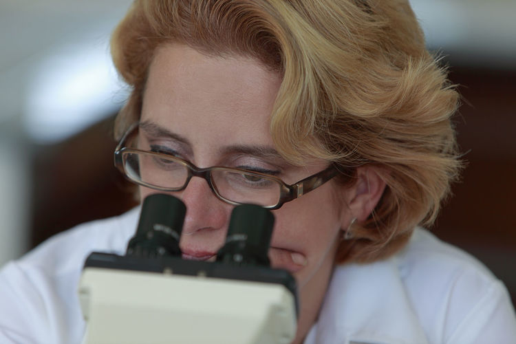Close-up of a female researcher thinking deeply in front of her microscope. Headshot Portrait Eyeglasses  One Person Glasses Indoors  Real People Close-up Blond Hair Lifestyles Technology Adult Thinking Research Researcher Researcher Life Microscope Education Learning Studying Eyes Science Scientific Experiment Scientist Lab Laboratory Medical Research Discovery