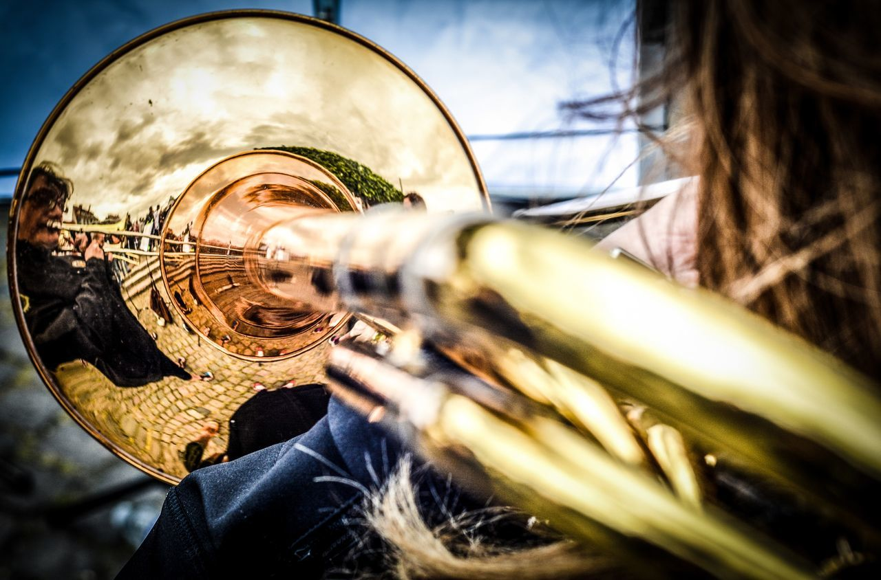 Reflection of musician on trumpet