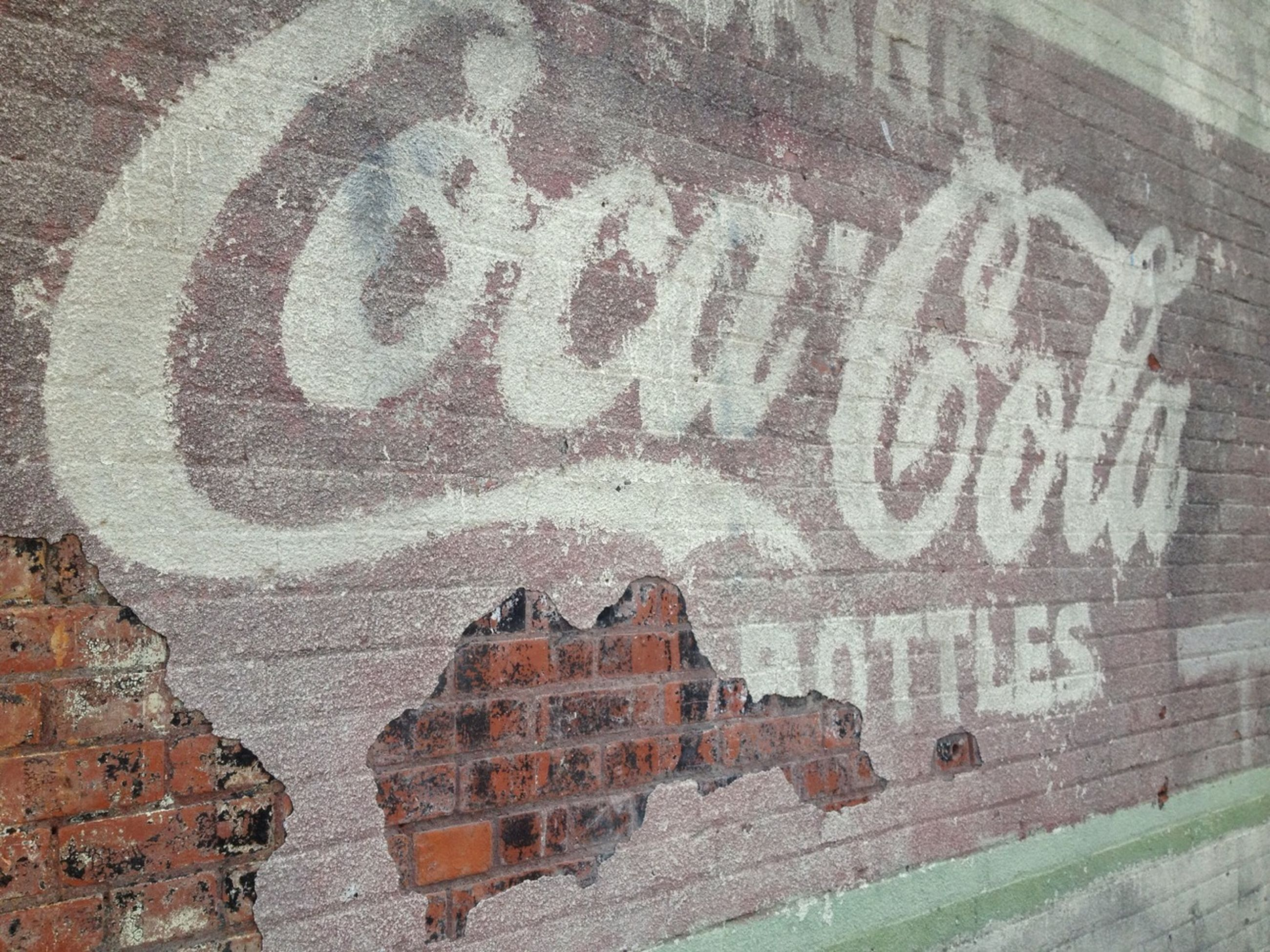 text, western script, communication, wall - building feature, graffiti, capital letter, built structure, non-western script, architecture, art, art and craft, high angle view, building exterior, outdoors, creativity, day, brick wall, wall, sign, no people