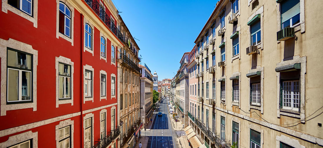 Colorful street Houses in Lisbon Architecture Beautiful Center City Cityscape Houses Panorama Panoramic Portugal Portuguese Road Travel View Aerial Alley Building Exterior Buildings Colorful Europe Lisboa Lisbon Street Summer Traditional Urban