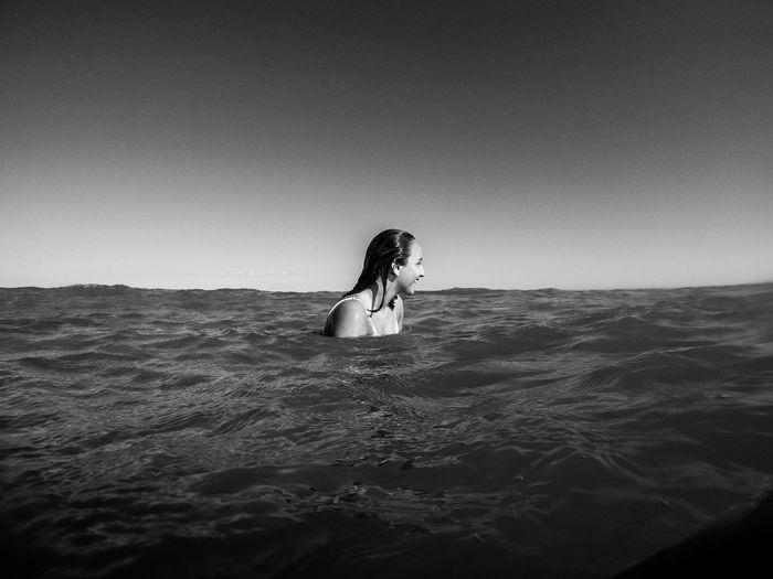 Woman Enjoying In Sea Against Clear Sky