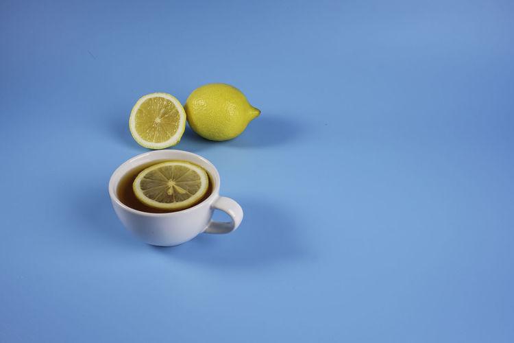 View of lemon against blue background