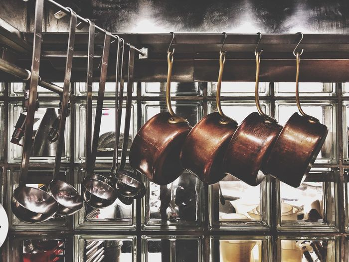 Sauce pans hanging in commercial kitchen