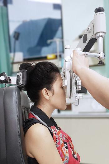 Woman doing eye checkup at hospital