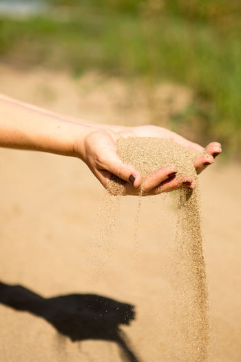 Close-up of hand holding sand