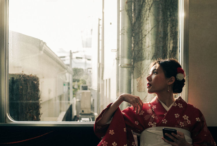 Good morning.. Japan Window Real People Looking Technology Lifestyles Indoors  Young Adult Transparent Holding Connection Communication Women Portrait Contemplation Hairstyle Kimono Japan Japan Photography Train Light And Shadow Light Kyoto Morning My Best Photo