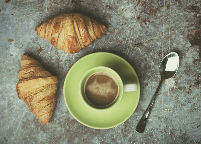 cup of coffee and croissants on Grunge background Coffee Cup Coffee With Milk Expresso  Breakfast Caffeine Cafeteria Croissant Pastry Food Drink Fresh Aroma Spoon Hot Snack Baked Bun Concept Delicious Tasty Bakery Morning Dessert Healthy Rustic Calories Nutrient Kitchen Cappuccino Closeup Bread Sweet Nutrition Background Food And Drink Mug Kitchen Utensil Coffee Cup Coffee - Drink Still Life No People Hot Drink