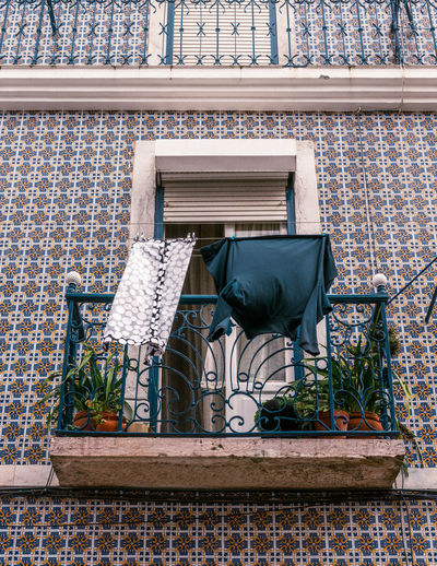Lisbon Lisboa Portugal Portugal Streetphotography Street Photography Travel Destinations Travel Tranquility City City Scape Film Photography Architecture Built Structure No People Day Building Exterior Plant Seat Building Wall Outdoors Nature Potted Plant Chair Window Brick Wall Wall - Building Feature Blue Brick Pattern Balcony