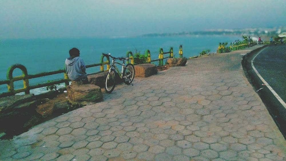 Best Hangout Spot For me in vizag 💕 Sea Outdoors People Water Bicycle Beach Adult Sky Nature Day View Eyesight Tranquility Travel Destinations EyeEm Selects Beachphotography Hill View Vizagdiaries Vizag Beach View Vizag Streetphotography Vacations Visakhapatnam Vizag City Let's Go. Together. Sommergefühle 100 Days Of Summer Perspectives On Nature