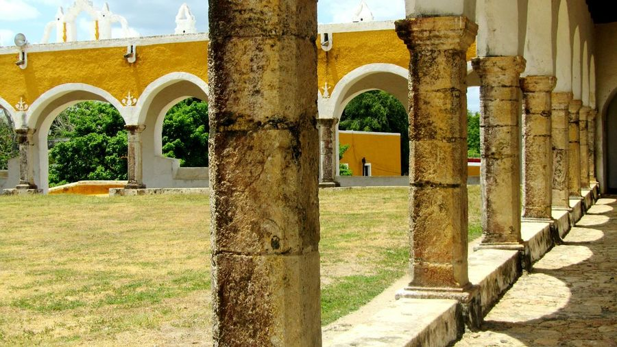 Izamal Yucatan Mexico Arch Built Structure Architectural Column History Religious Architecture Travel Destinations Yellow The Past Tranquility Archway Perspective Photography EyeEm Gallery